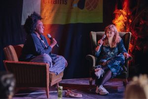 Two women laughing during fireside chat at DOTI Fest 2019
