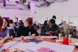 People discussing something at DOTI Fest 2019
