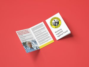 A photograph of a Neighbourhood Watch information leaflet about fraud titled 'Working together against fraud'