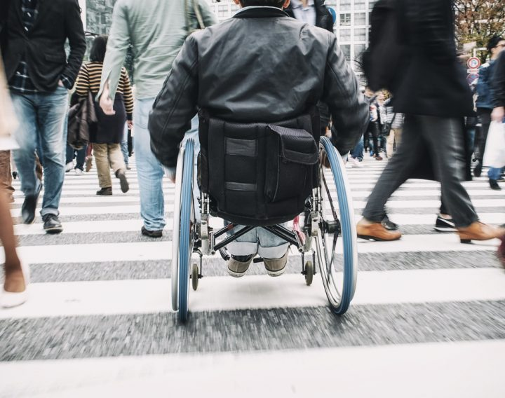 A man in a wheelchair in the Shibuya Ward of Tokyo, Japan.