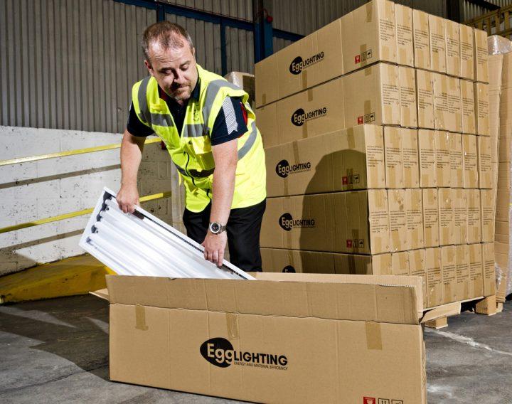 EGG Lighting engineer unpacking lighting equipment from box to install