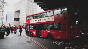 a photograph of a double decker bus in Camden, London